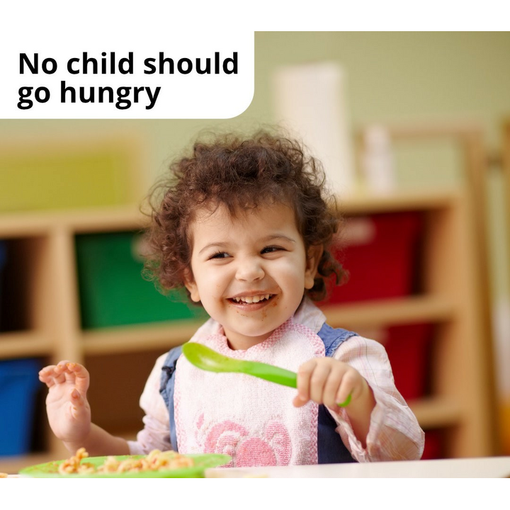 Child enjoying a free school meal